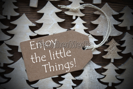brown christmas label with enjoy the