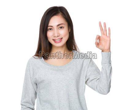 asian woman with ok sign gesture