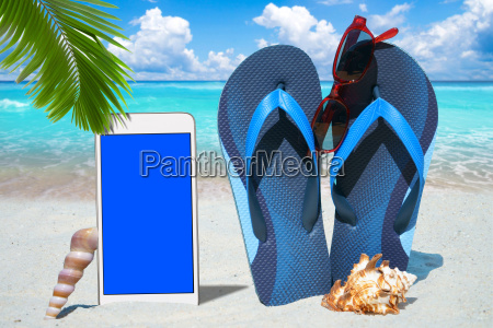 smartphone flip flops and sunglasses on