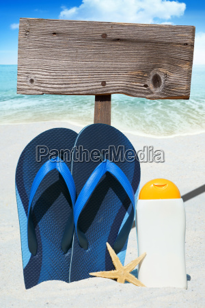 flip flops suntan lotion and empty
