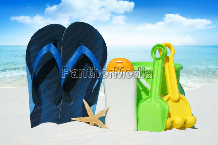 flip flops sun cream starfish and