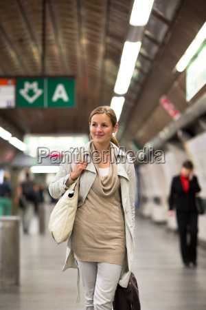 elegant smart young woman taking the