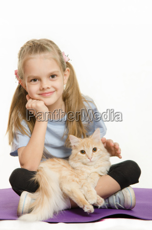 six year old girl athlete sitting