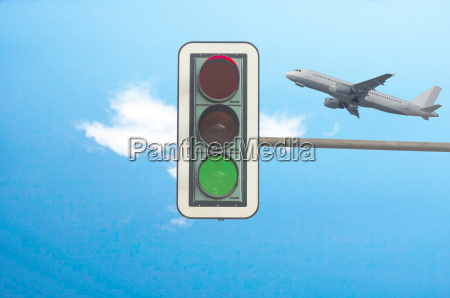 green traffic light airplane in background