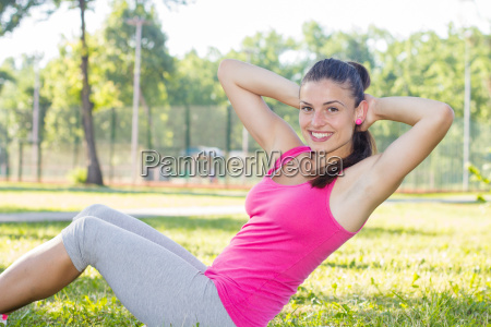 sporty fit healthy young woman outdoor