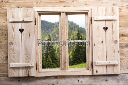wooden window with mountain reflections
