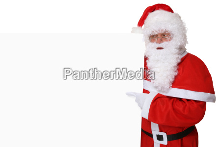weihnachtsmann nikolaus mit muetze zeigt an