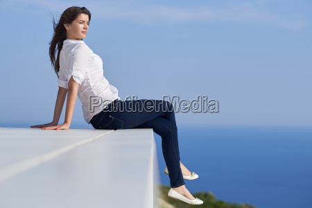 relaxed woman in front of luxury