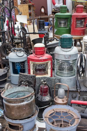 flea market stall with various oil