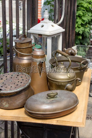 flea market stand with brass pots