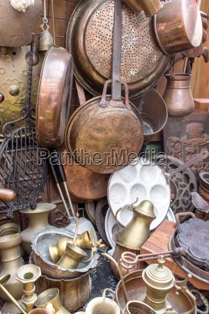 flea market stand with brass pans