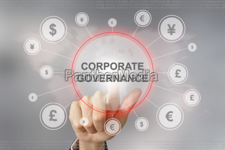business hand pushing corporate governance button