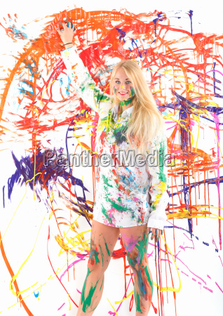 young woman with finger paints