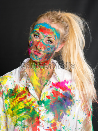 blond girl is painted with finger
