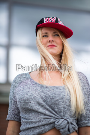dreamy blonde skater with a baseball