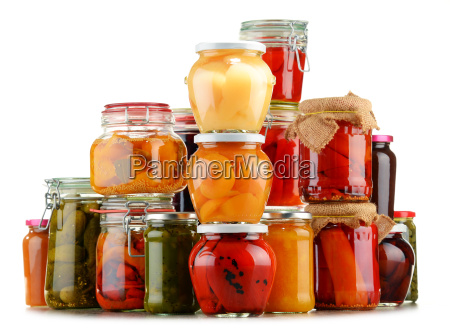 jars with pickled vegetables and fruity