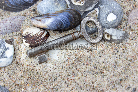 old key with stones and shells