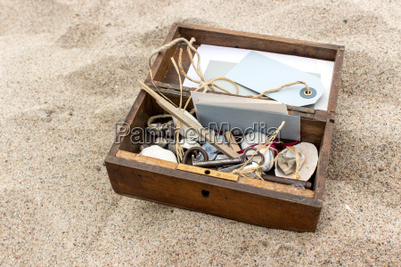 wooden box with cards stones and