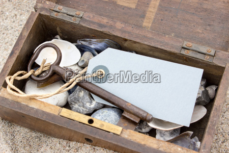wooden box with keys pendants stones