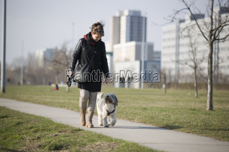 woman with dog on a way