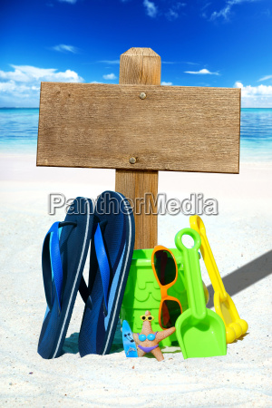 beach toys flip flops and wooden