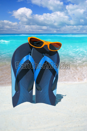 sunglasses on blue flip flops on