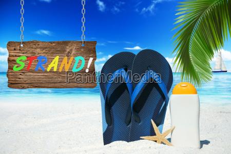 beach with flip flops suntan lotion