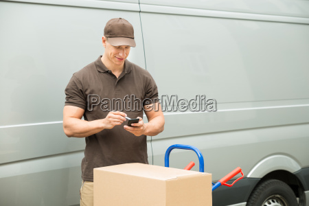 delivery man checking list on mobile