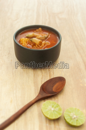 spicy sour soup vegetable on wooden