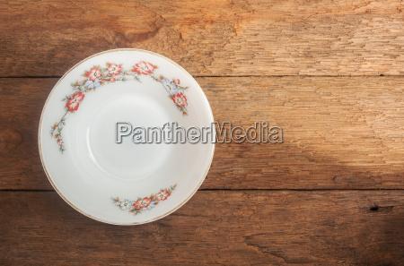 old white ceramic dish on wood