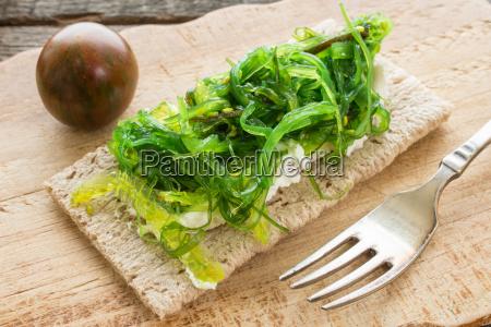 slice of crispbread with wakame seaweed