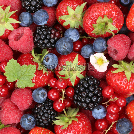 fruit berries background with strawberries raspberries