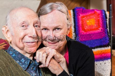 smiling happy elderly couple