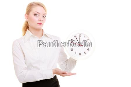 portrait businesswoman showing clock time for