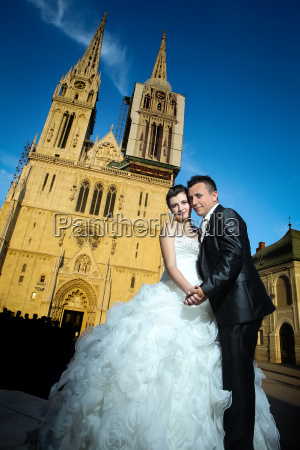 married couple in front of cathedral