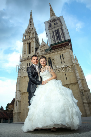 newlyweds holding hands in front of