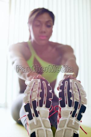 home fitness black woman doing legs