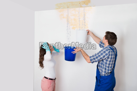 woman with worker collecting water from