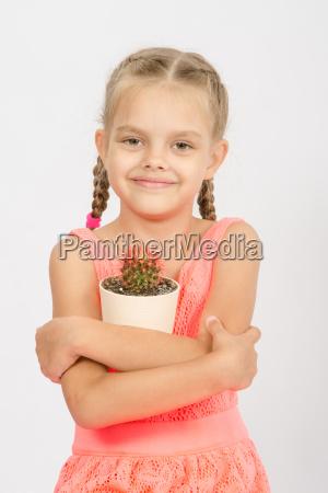 happy little girl hug pot of
