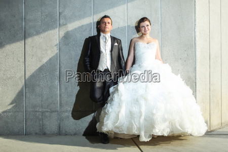 bride and groom posing in front