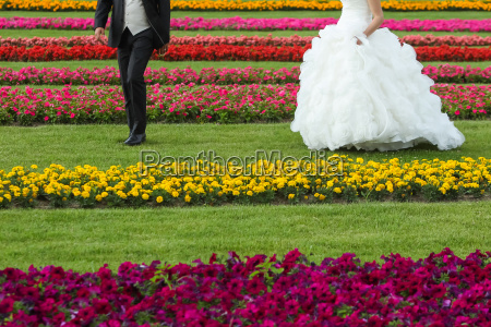 bride and groom seen from waist