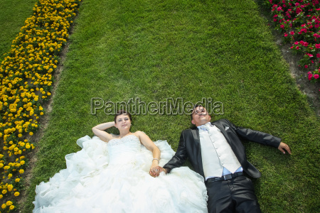 bride and groom on lawn with