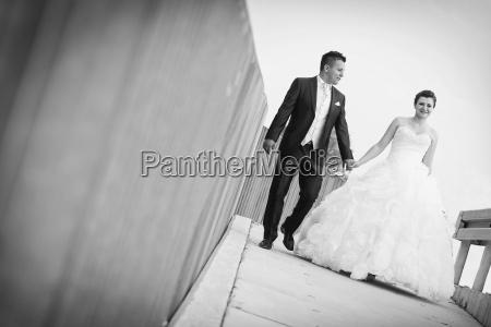 bride and groom walking in city