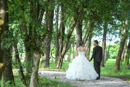 bride and groom walking in nature