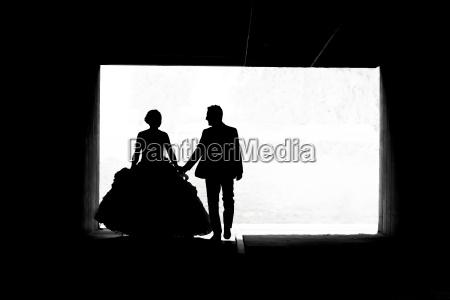 bride and groom walking in passage