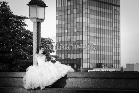 bride posing in city black and