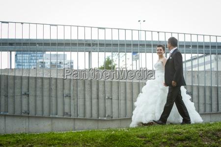 newlyweds walking in city