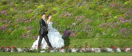 newlyweds walking on pathway
