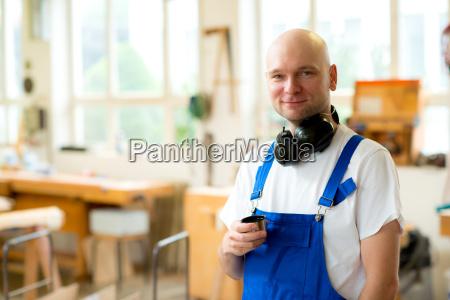 worker in a carpenters workshop