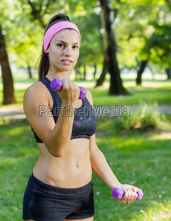 fitness slim woman training with dumbbells